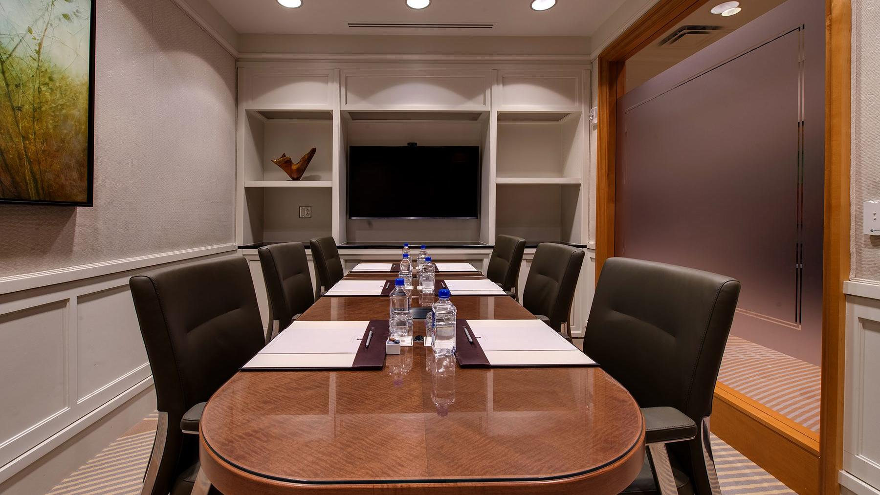 conference room with long table and black chairs