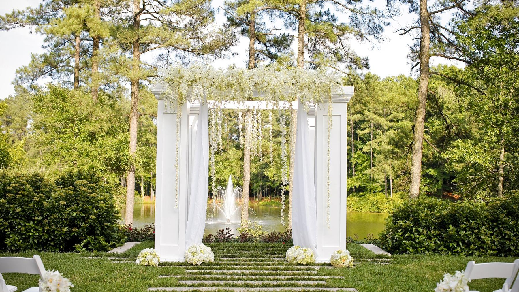 floral white alter in outside wedding venue