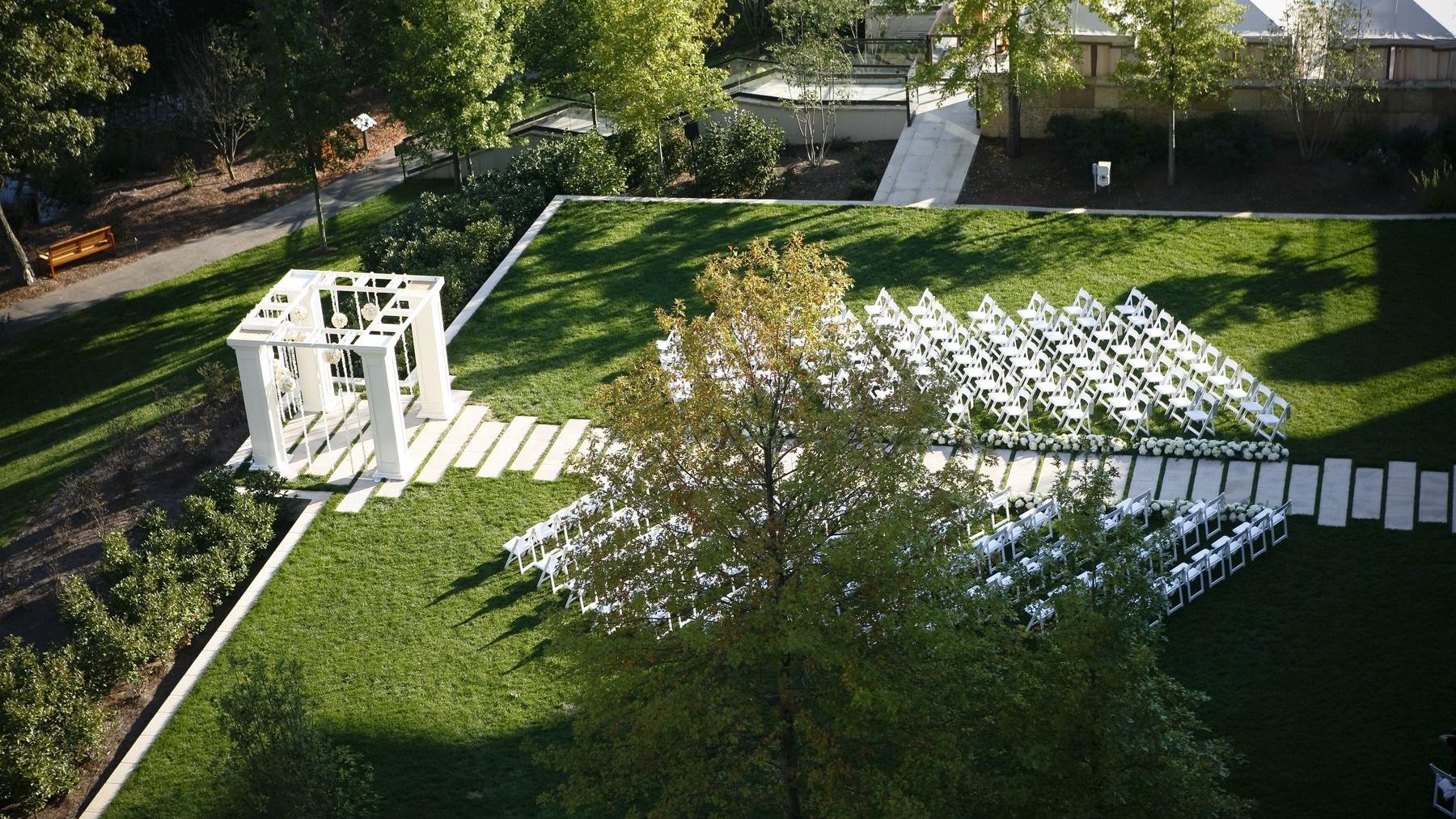lawn with white wedding alter and white seats