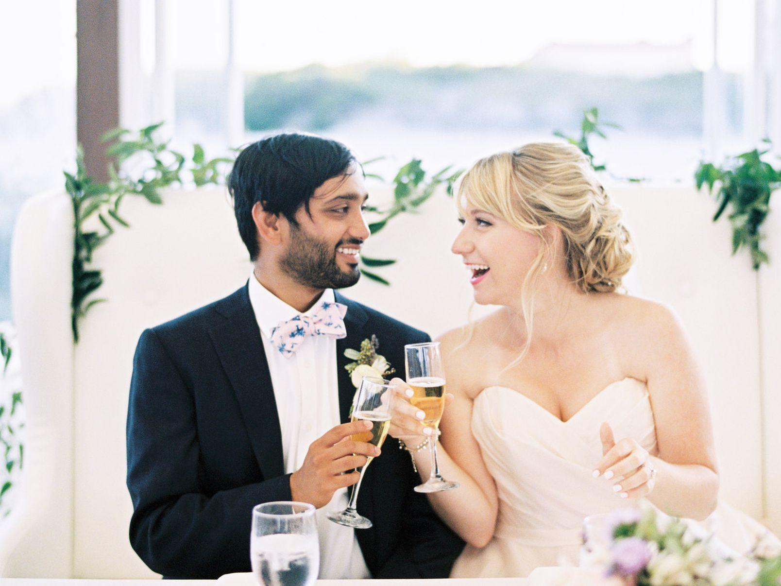 wedding couple holding glasses of champagne