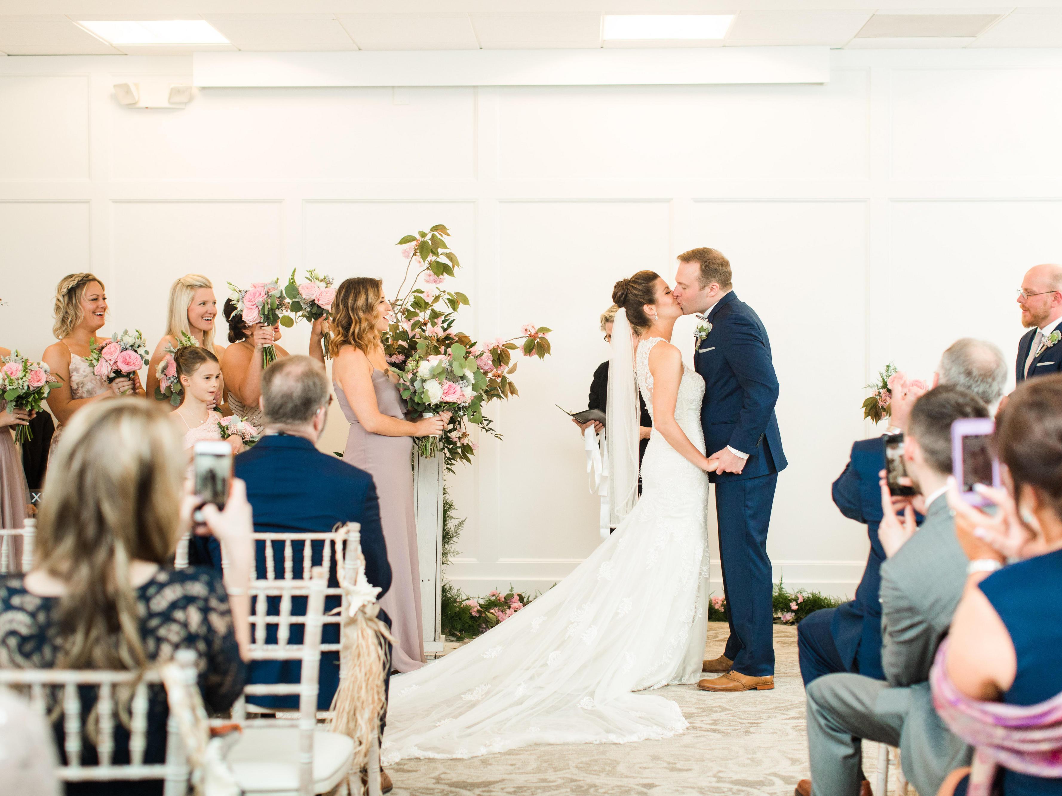 wedding couple kissing during wedding ceremony