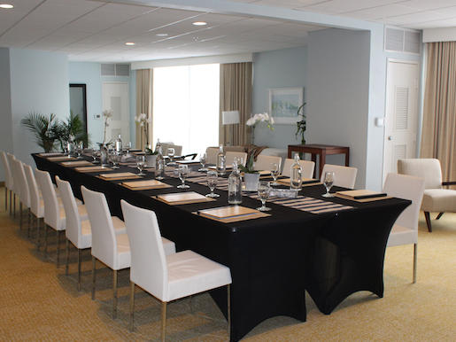 meeting roomo with large table and chairs