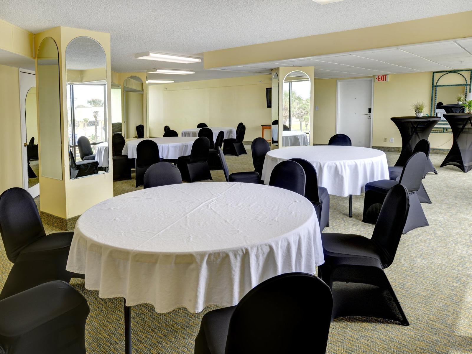 Meeting room with round conference tables.