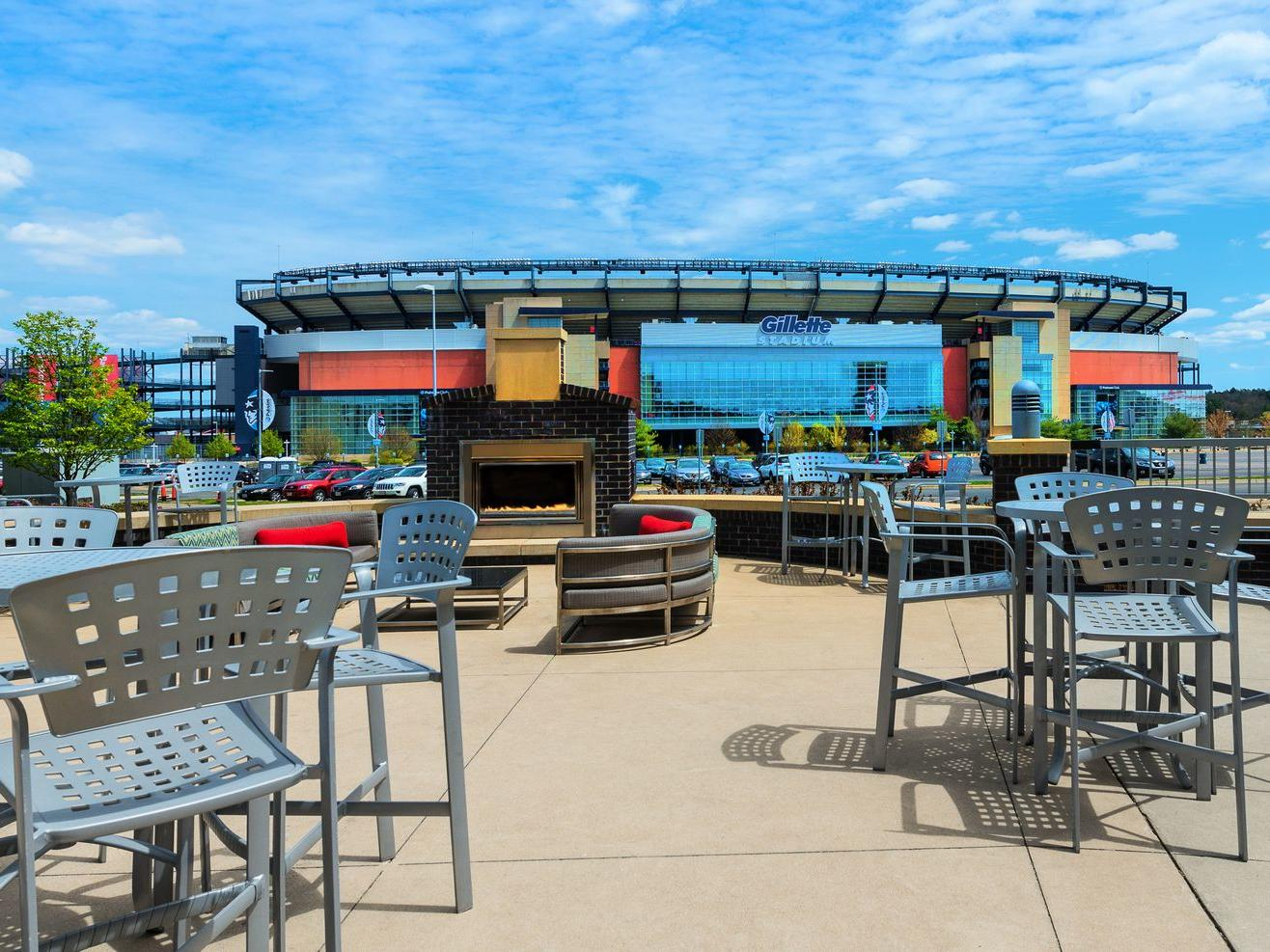 outdoor lounge with view of gillette stadium