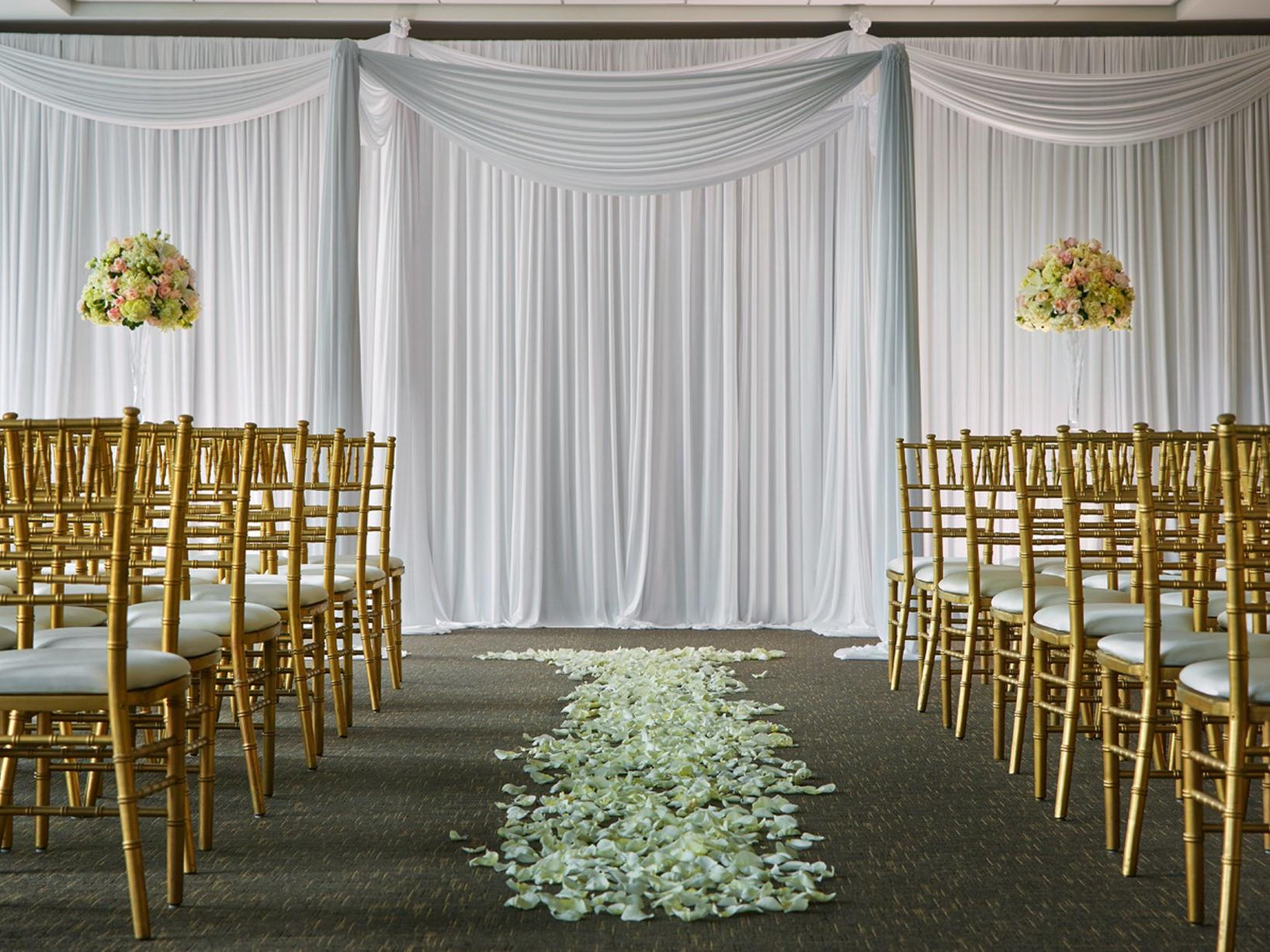 chairs and flowers in a wedding ceremony