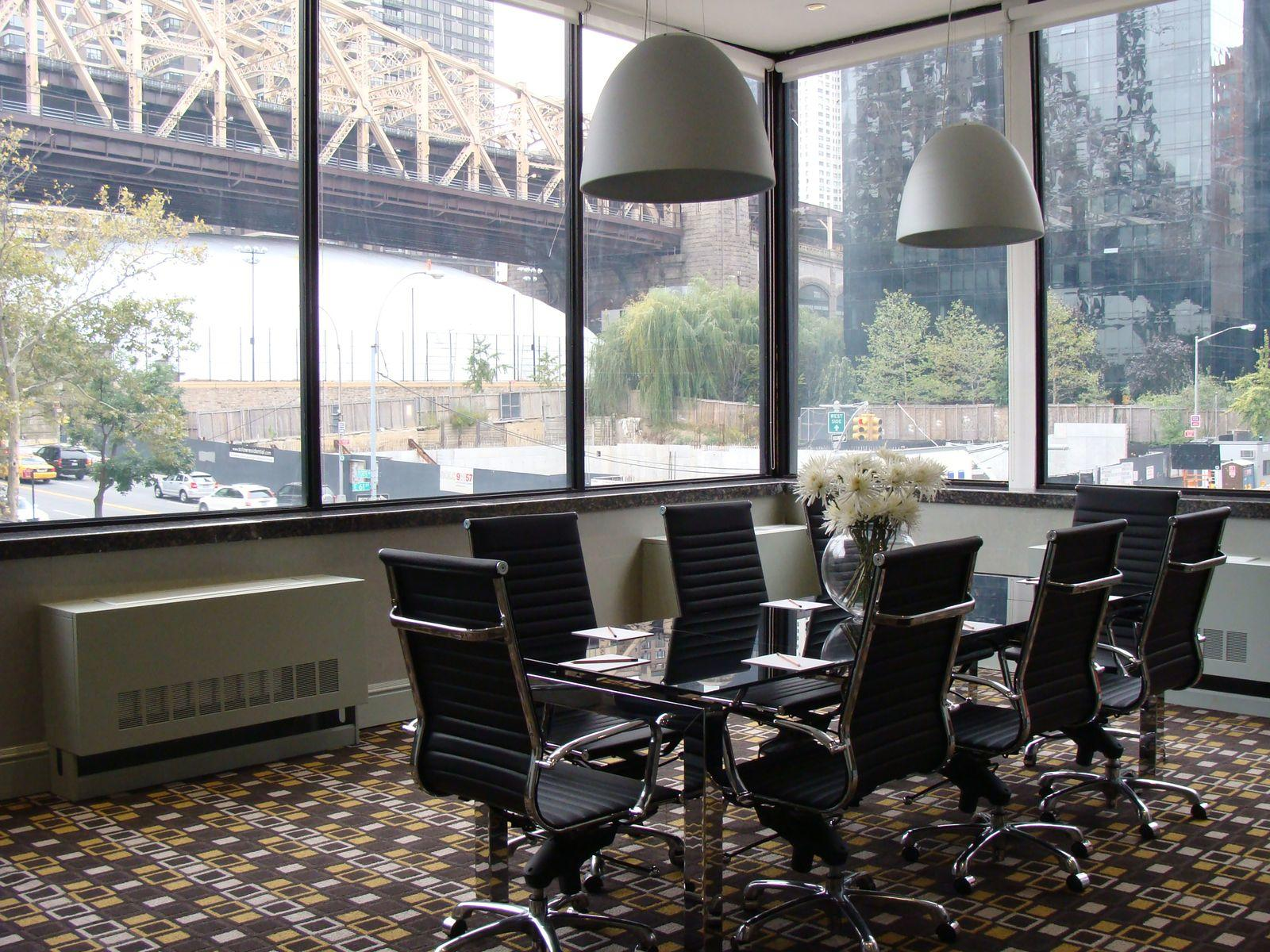 chairs surround a conference table