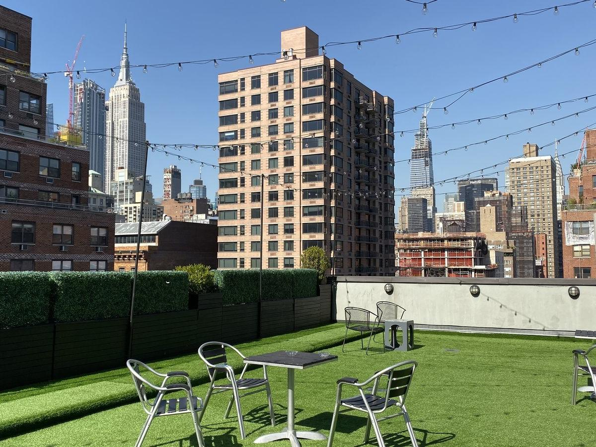 rooftop area with chairs and tables