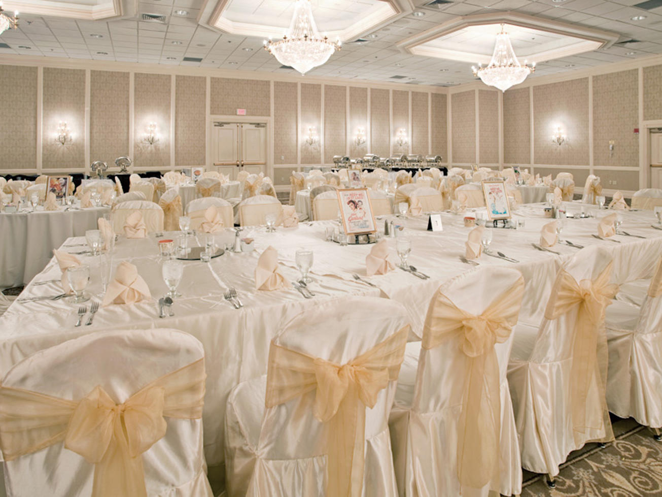 decorated tables and chairs in a ballroom