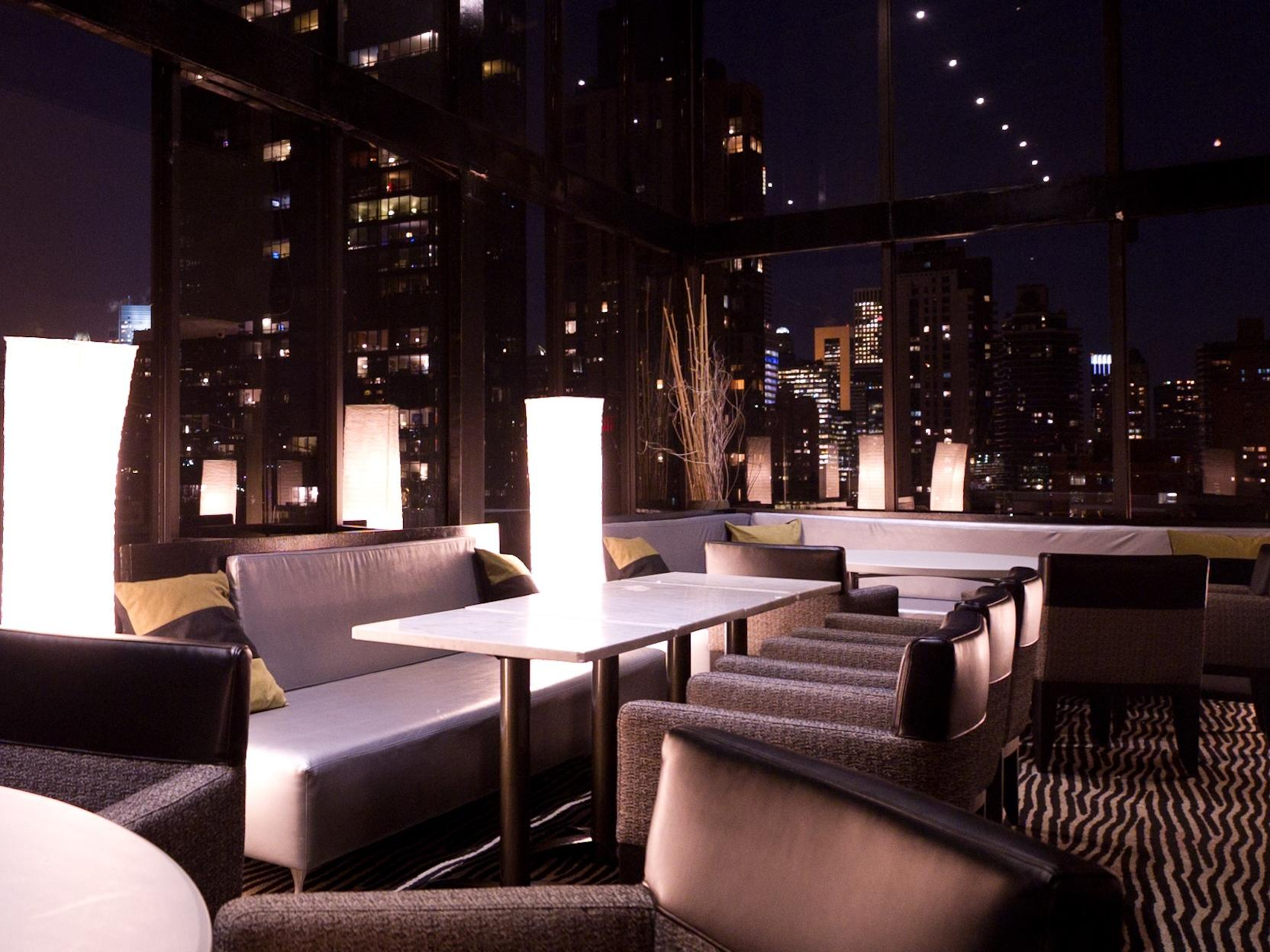 chairs and couches in a rooftop event space