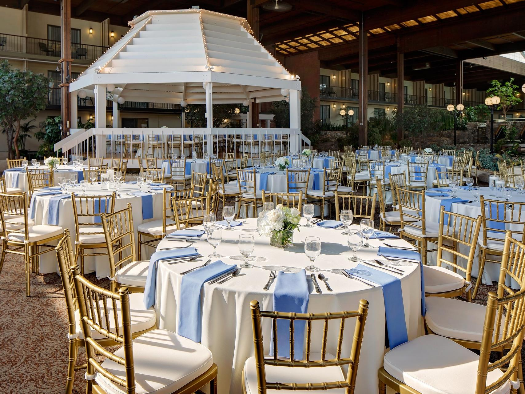Wedding venue tables in atrium