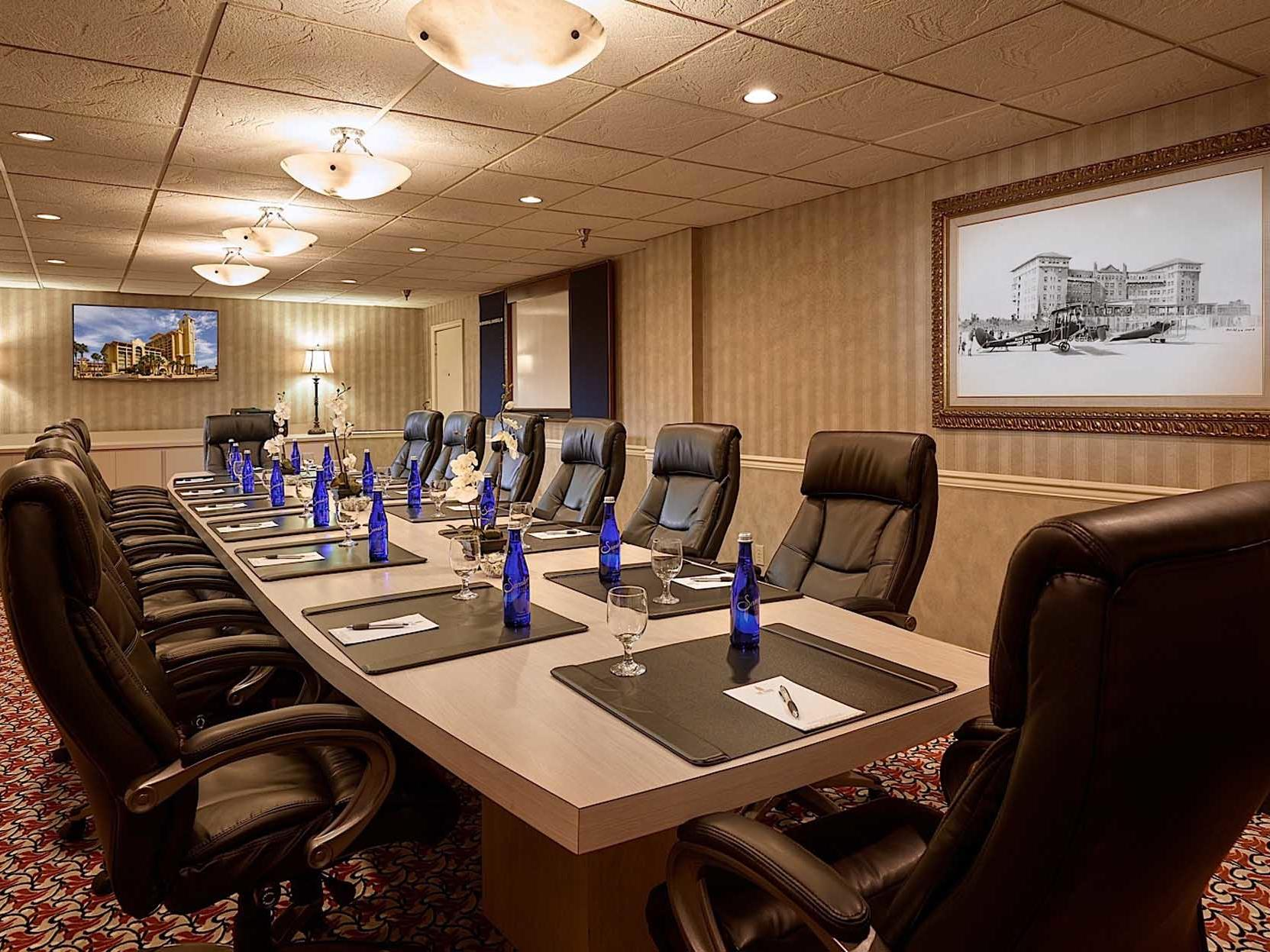 meeting room with conference table and desk chairs