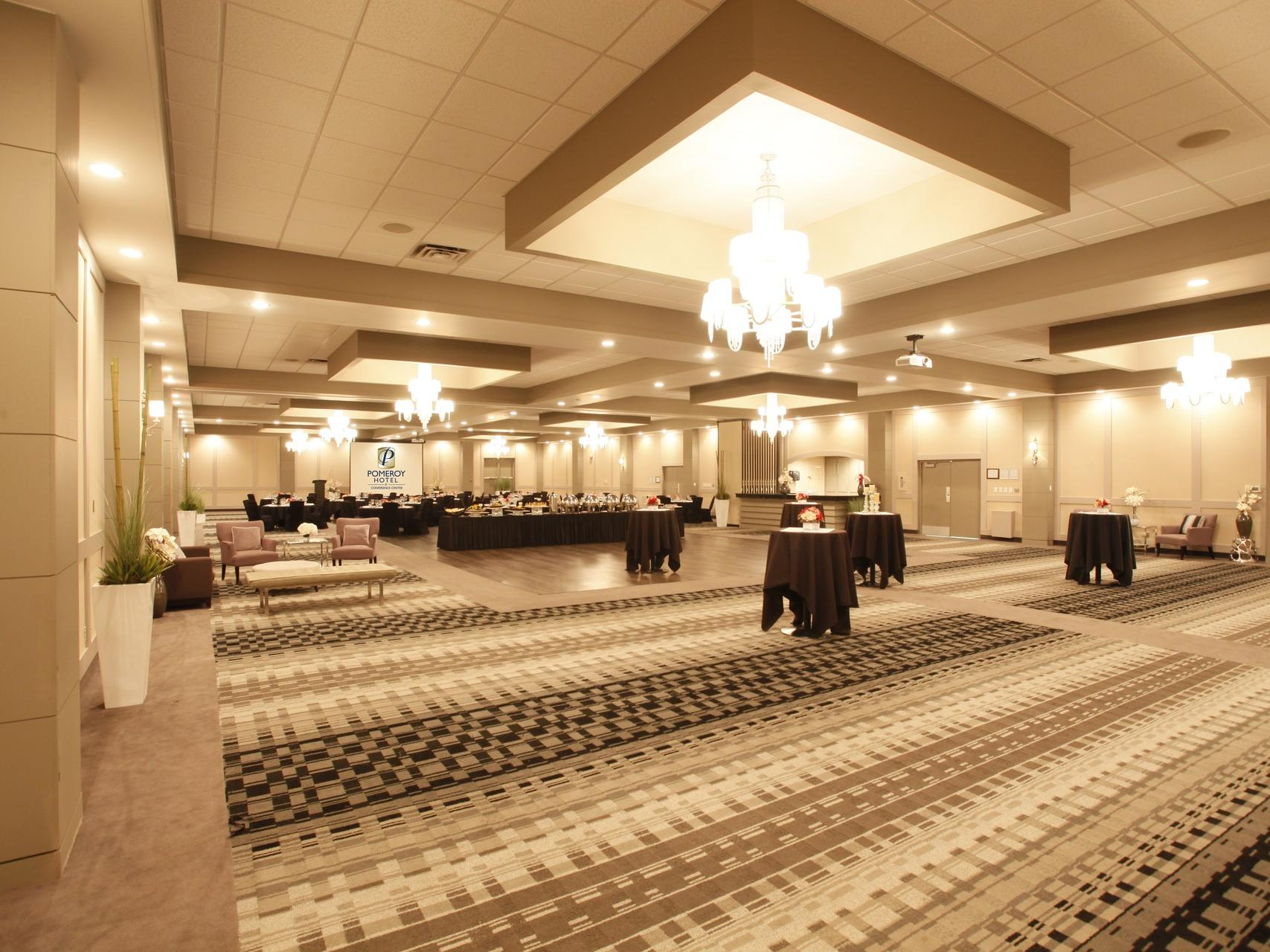a large room with chairs and tables