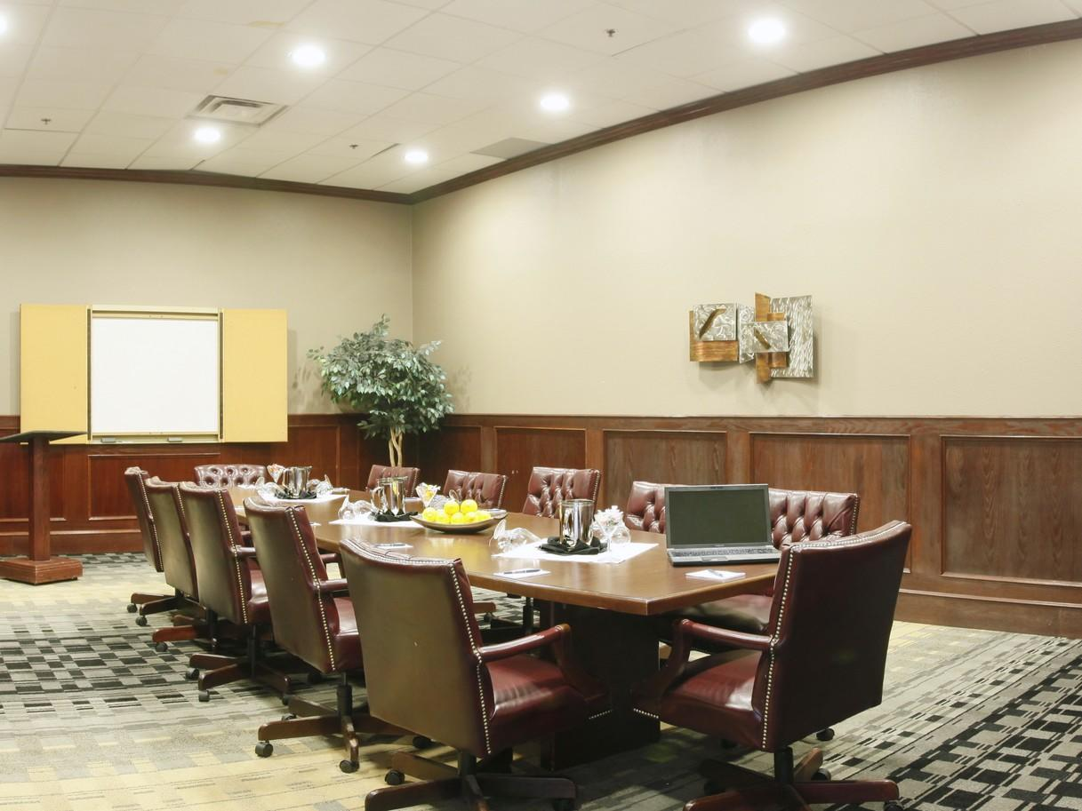 a large conference table in a boardroom