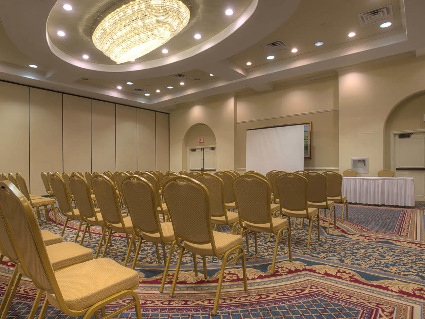 conference room with rows of chairs and projector