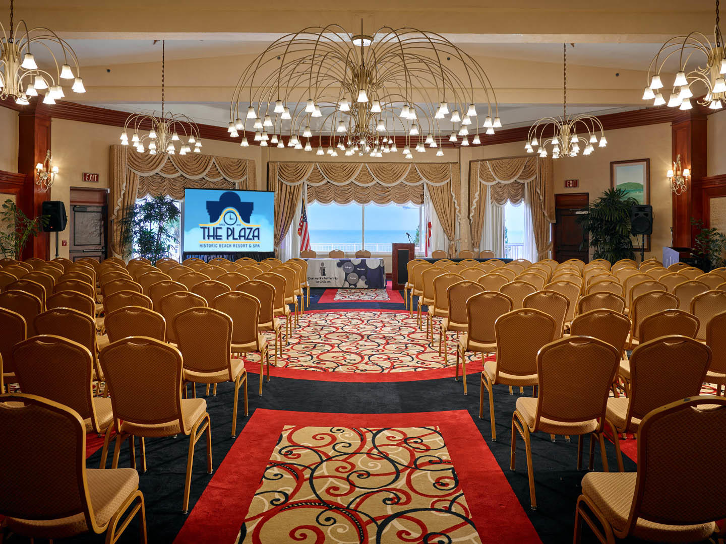 meeting room with rows od chairs and podium in front
