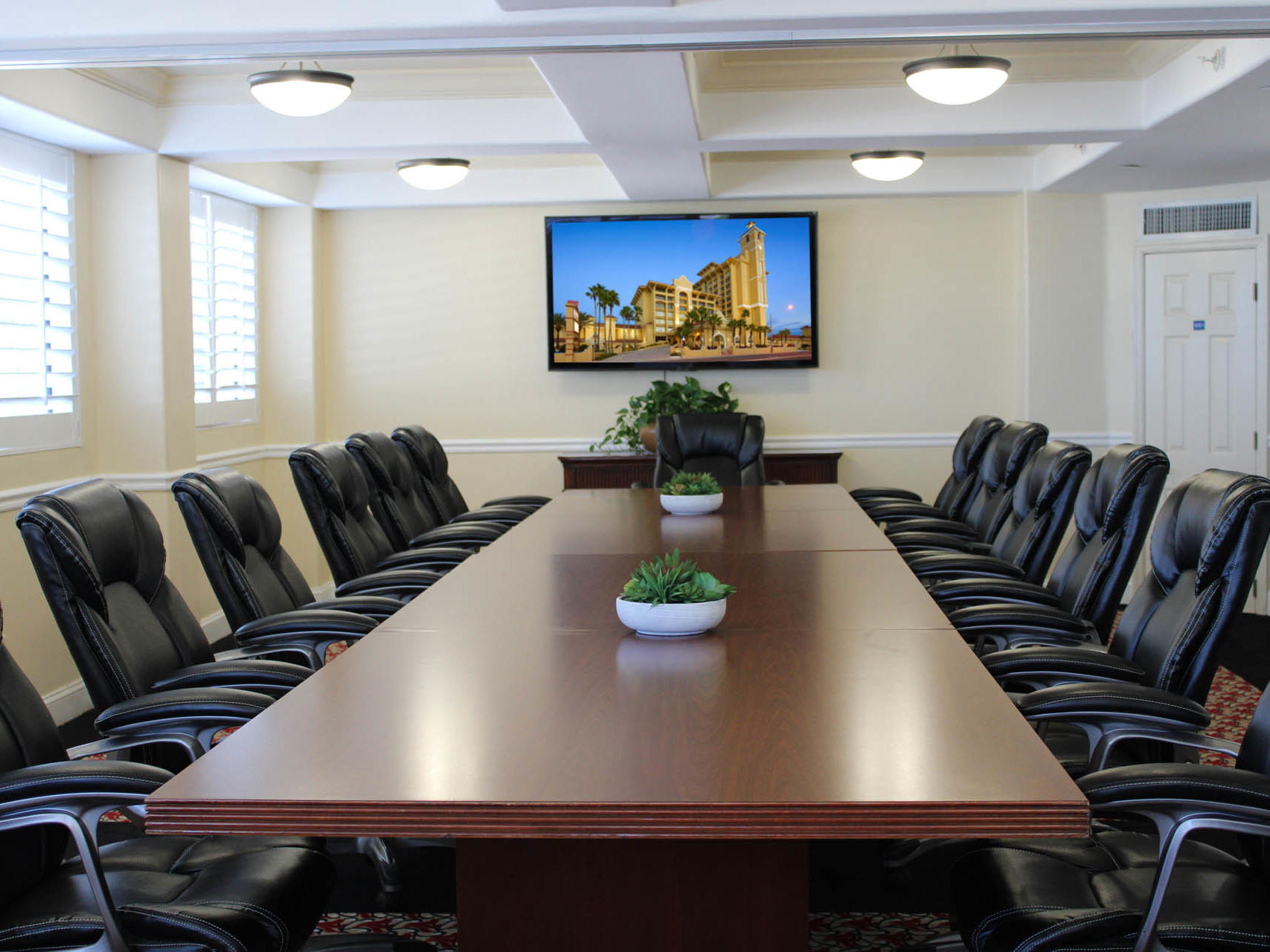 room with conference table and executive chairs