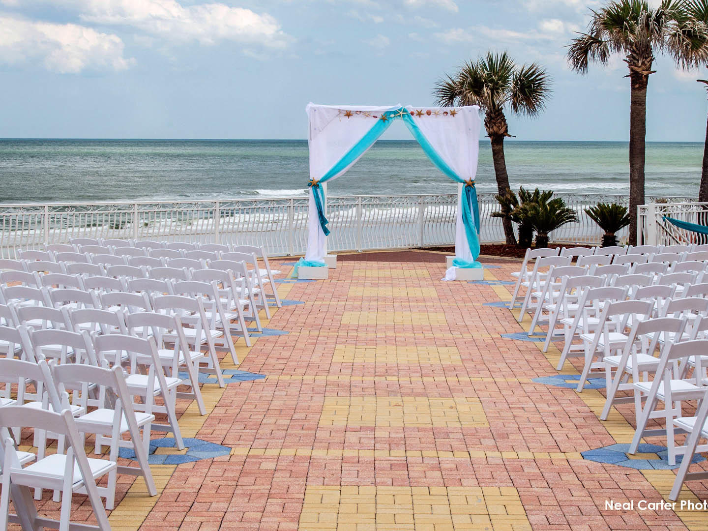 outdoor terrace with chairs and wedding arch