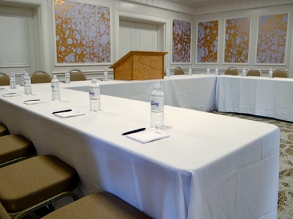 chairs at a u-shaped conference table