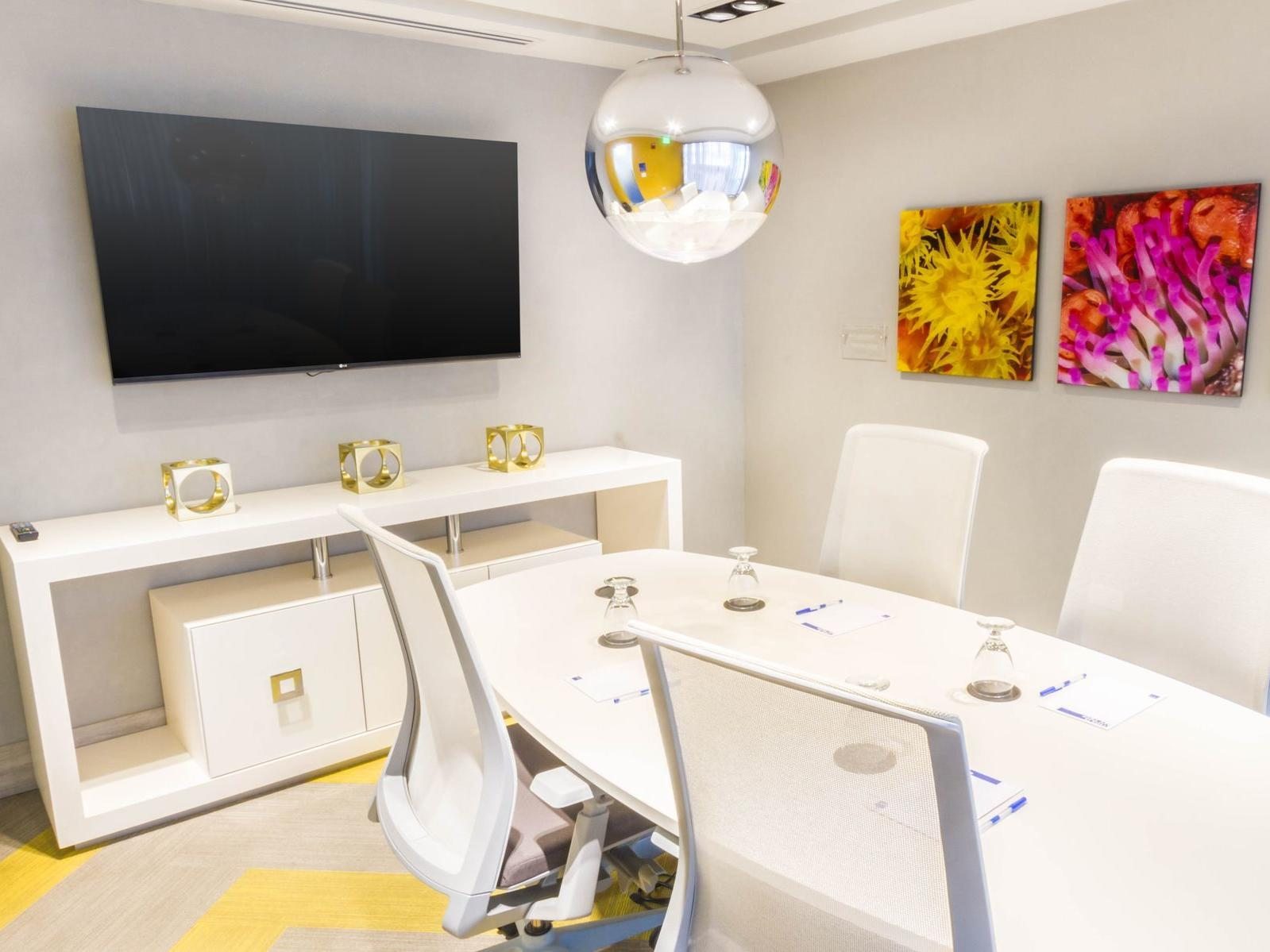 meeting room with conference table, chairs and television