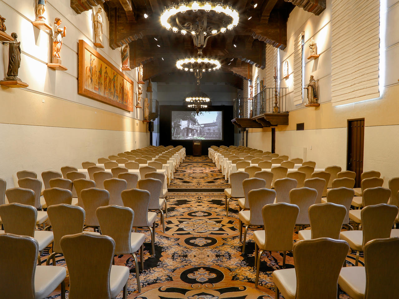 conference with large projection screen and chairs