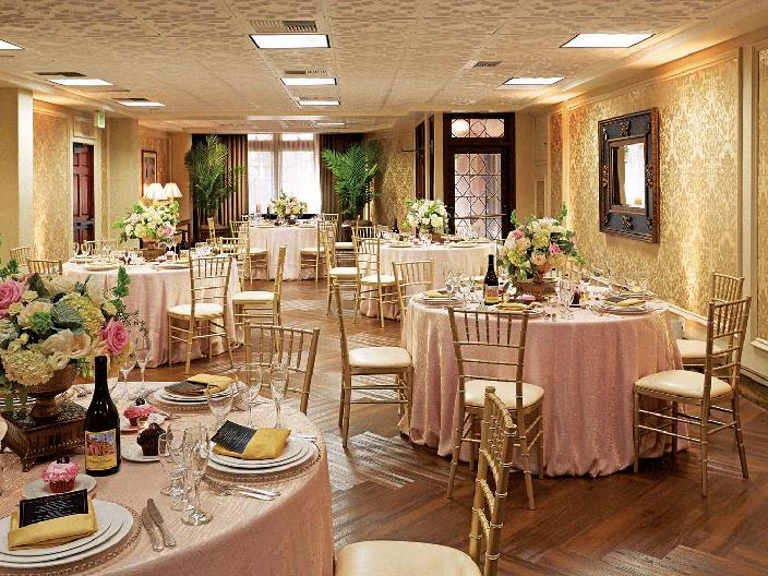 Mission Inn ballroom with decorated tables, chairs and flower centerpieces