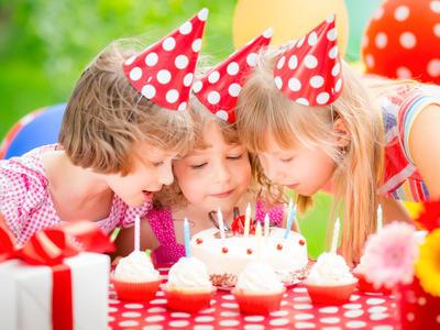 Kids blowing candles on cake at  Artyzen Grand Lapa Hotel Macau