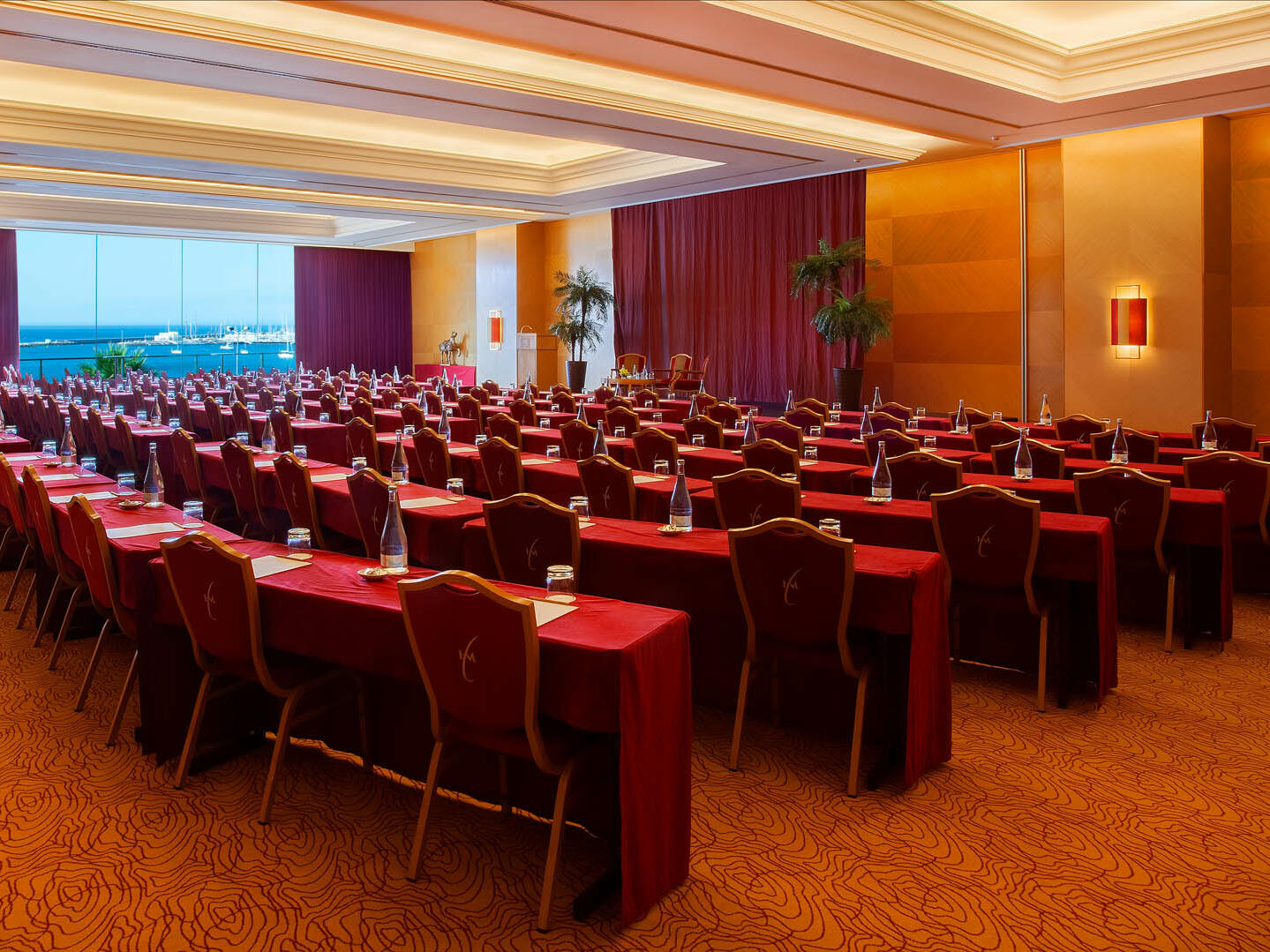 Meeting room arranged with red chairs at Hotel Cascais Miragem
