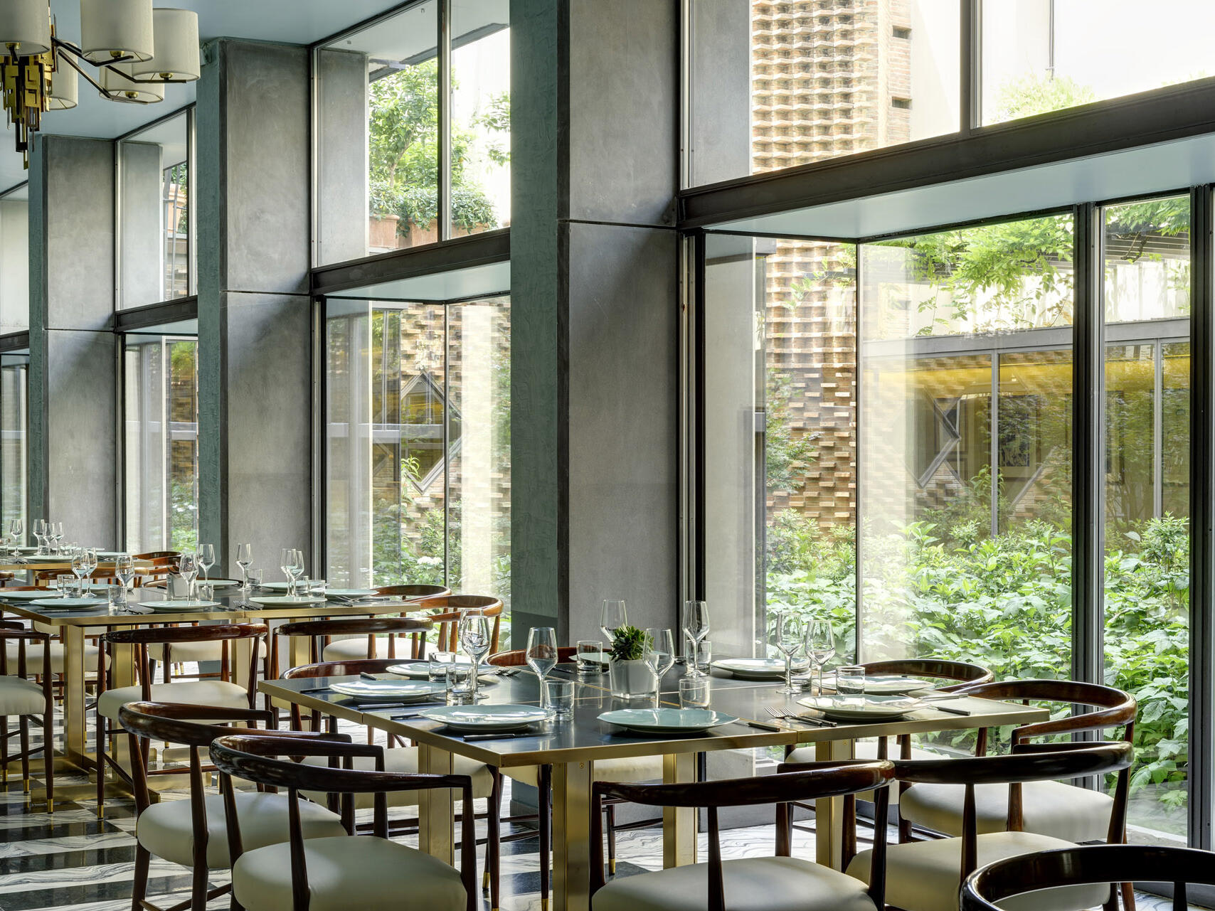 Dining Room with glass wall at Grand Hotel Minerva