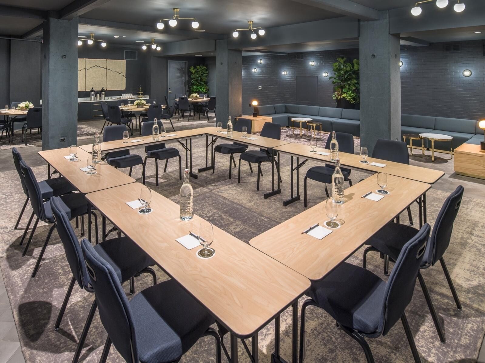 conference room with square table and mixed seating