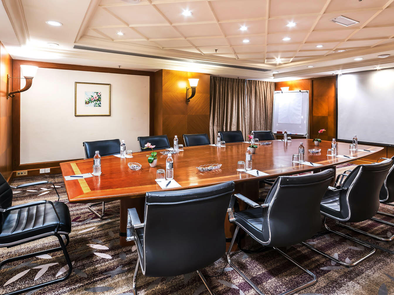 The Pepatih meeting room arranged with a wooden table and black chairs