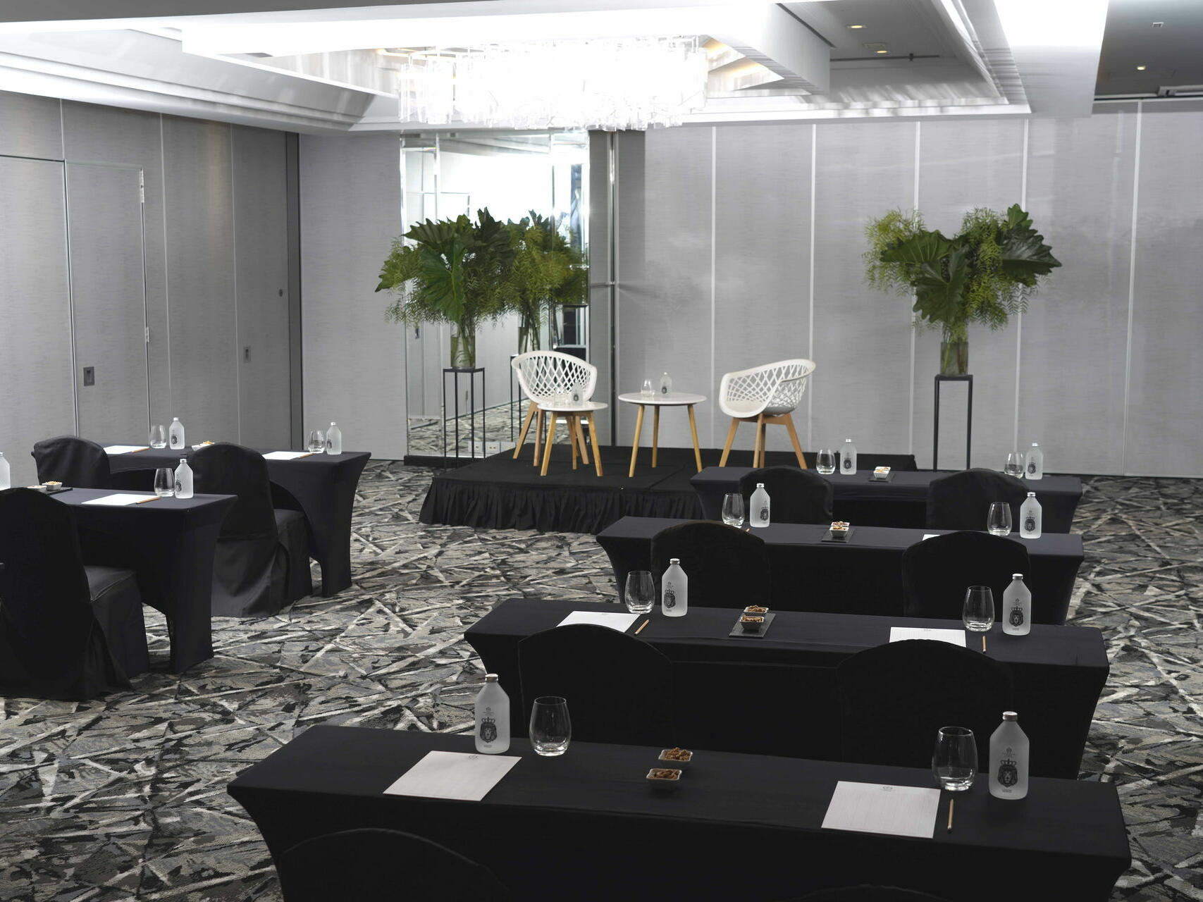 Granada meeting room arranged with black tables and chairs at Hotel Emperador Buenos Aires