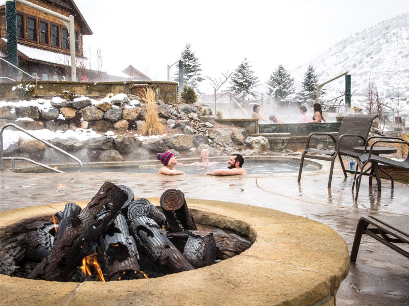 winter scene hot springs with fire pit in foreground