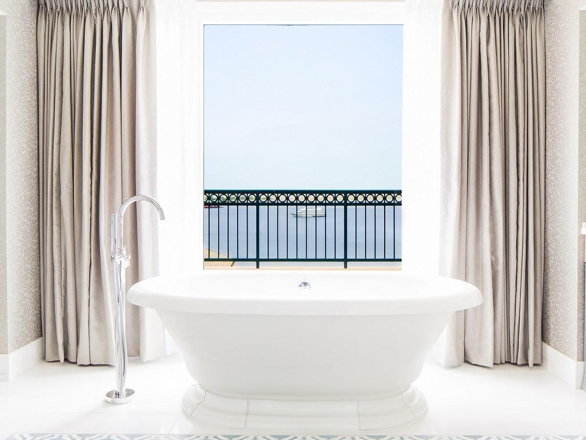 Luxurious bathtub with harbor views