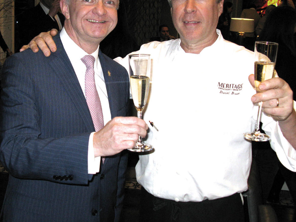 Chef and Boston Wine Festival attendee with glasses of champagne