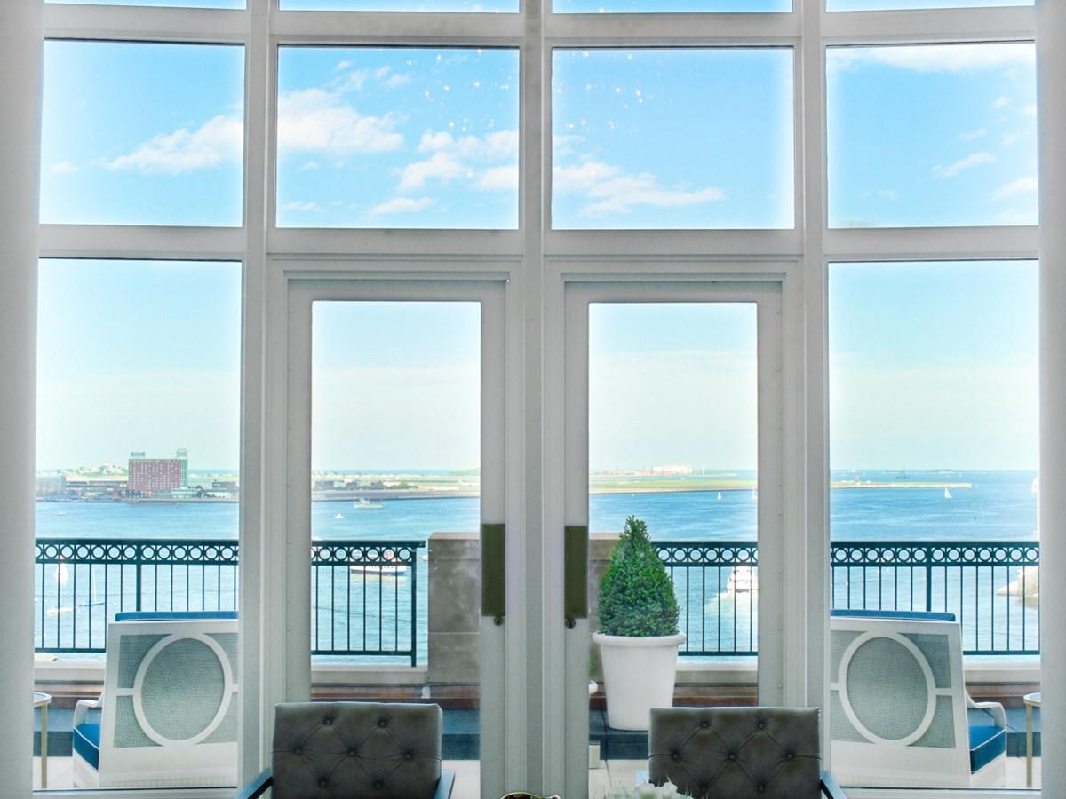 French doors leading out to private balcony with harbor views