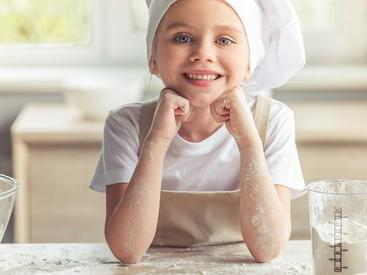 Young girl baking in chef's at