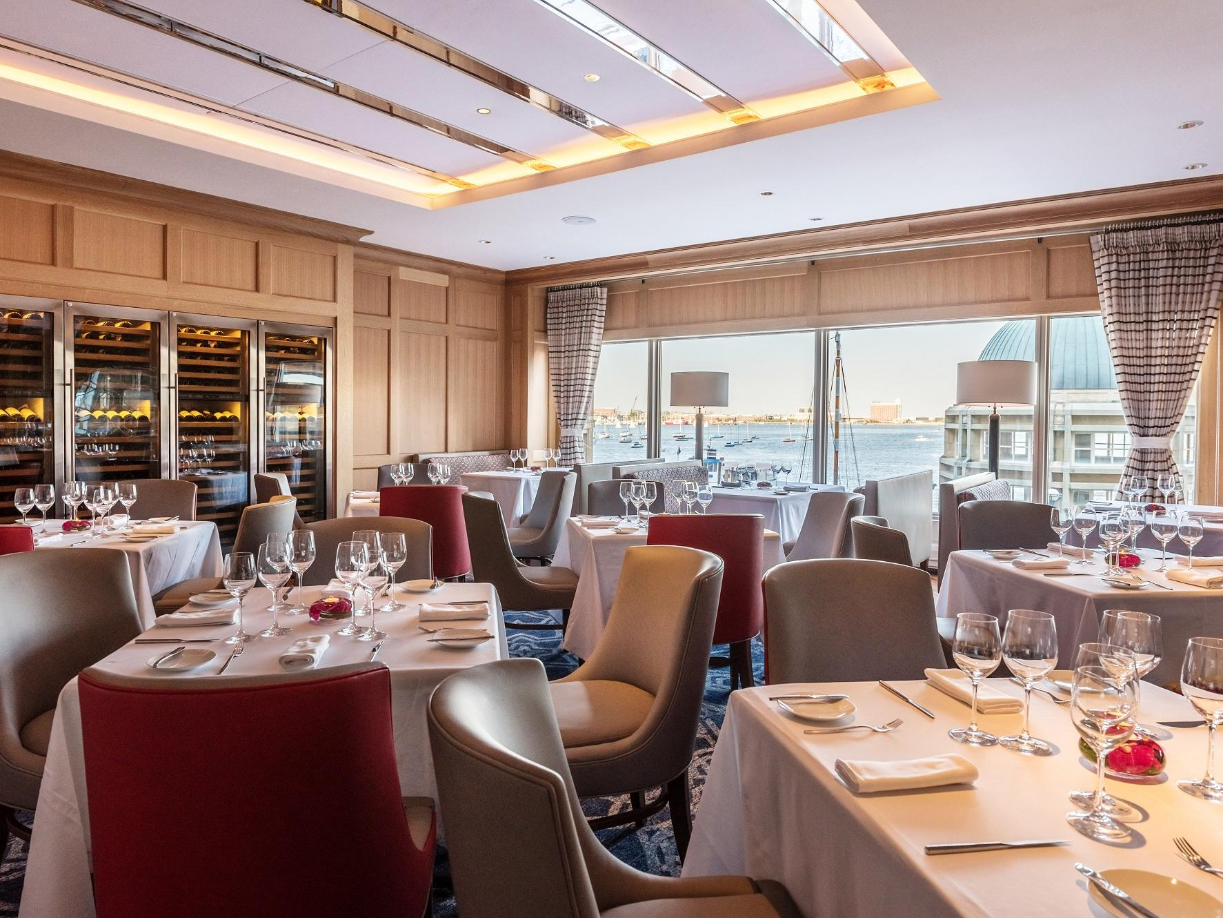 Restaurant seating with harbor views