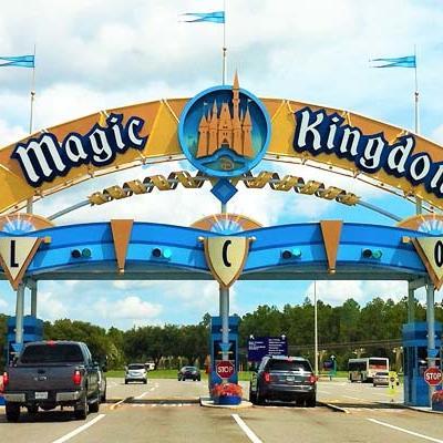 cars driving through the entrance to Magic Kingdom