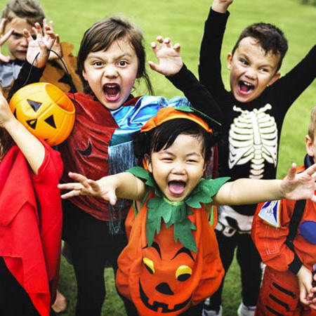 a group of kids dressed in halloween costumes