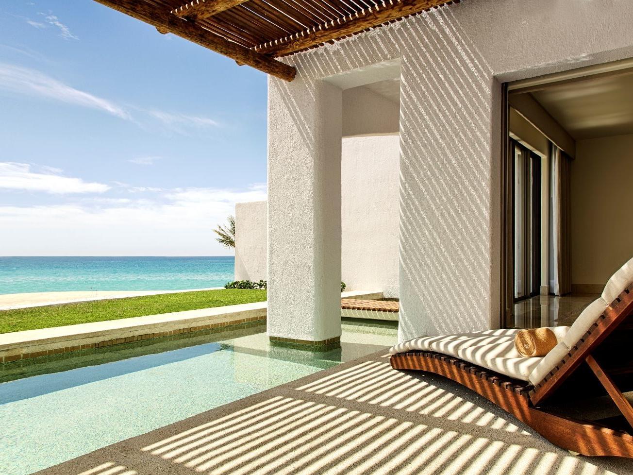 a chair under an overhang facing the ocean