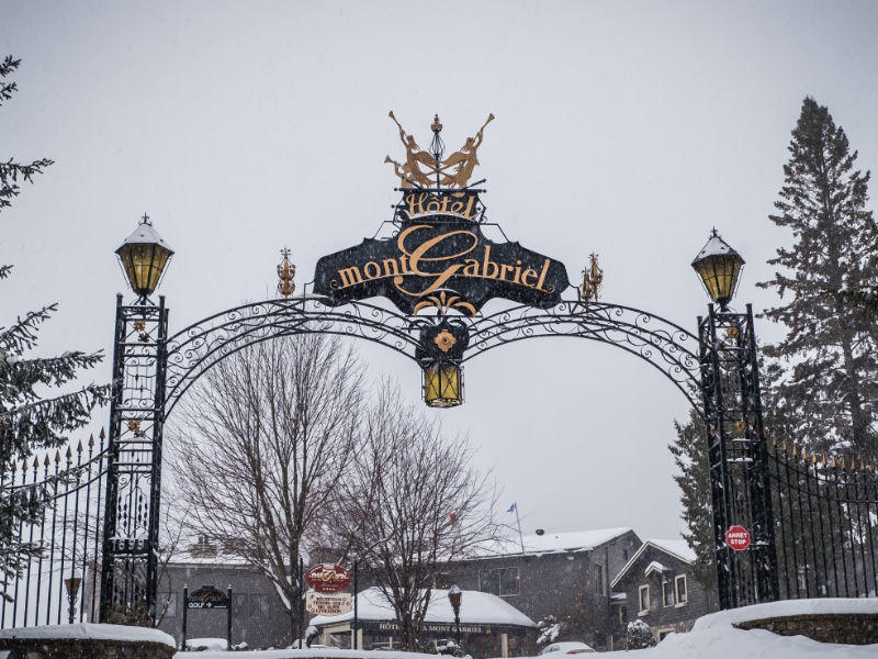 Snow covered metal arch entrance