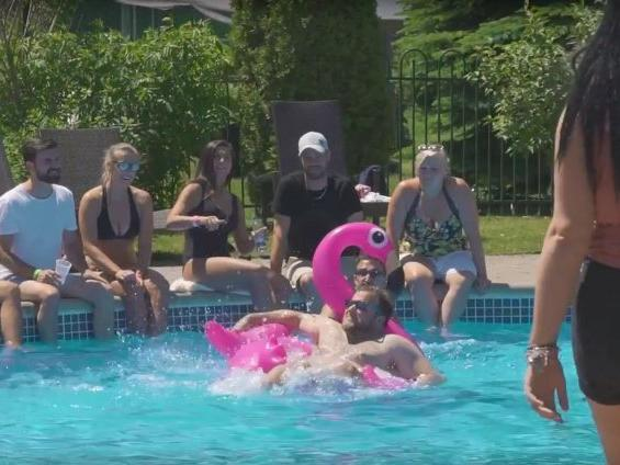 Group of people cooling off at a pool