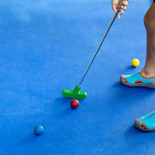 a person playing mini golf