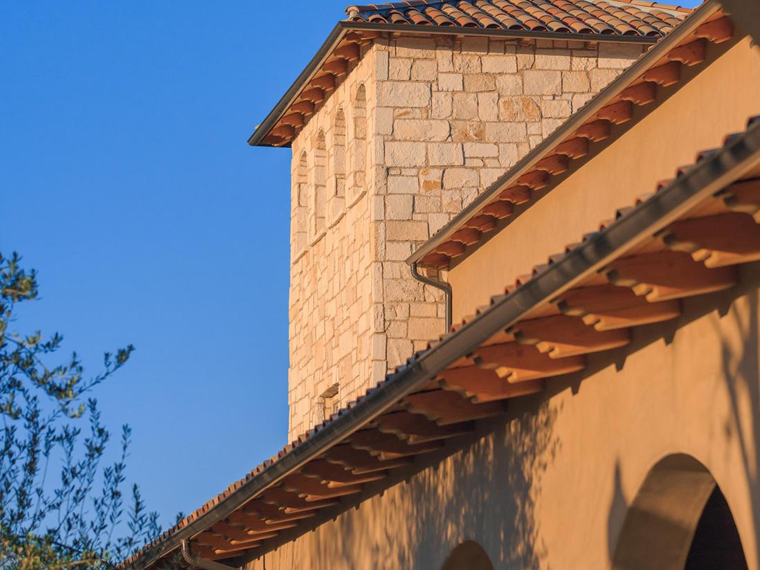 View of Allegretto Vineyard Resort exterior through archway