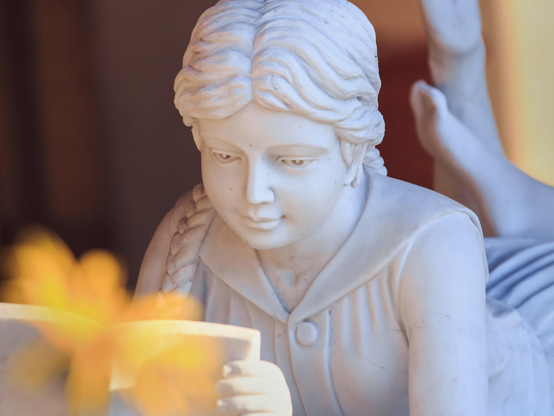 Sculpture of girl reading
