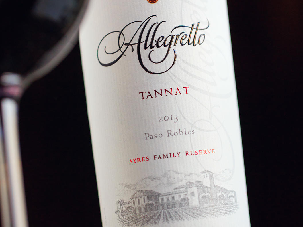 Allegretto bottle of house tannat wine and wine glass