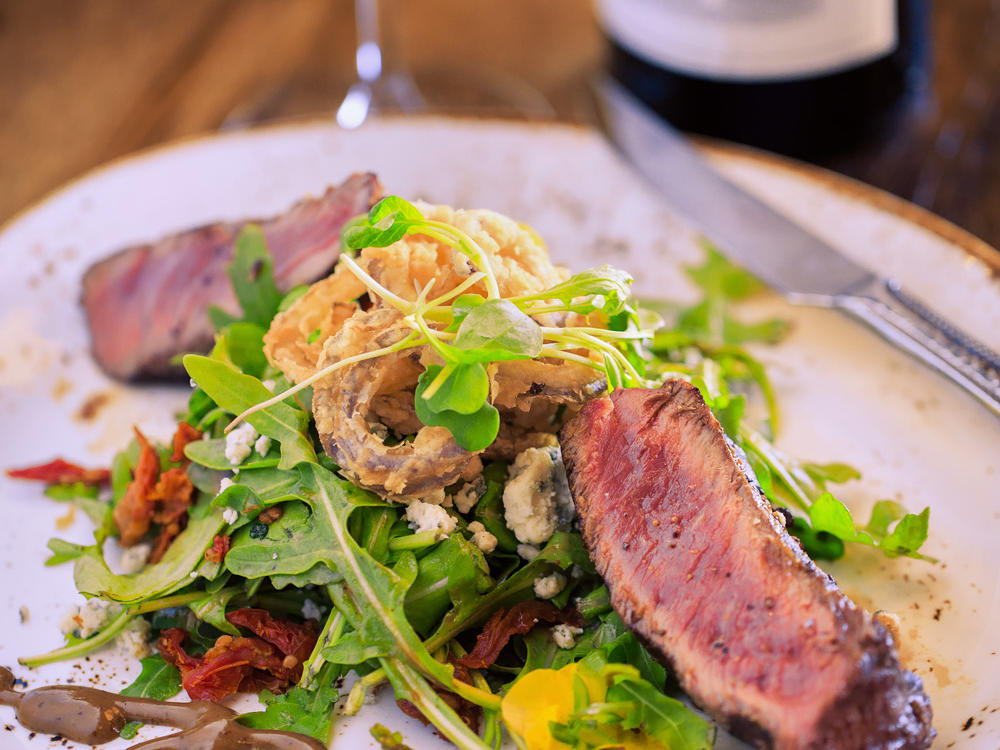 Steak salad and glass of red wine
