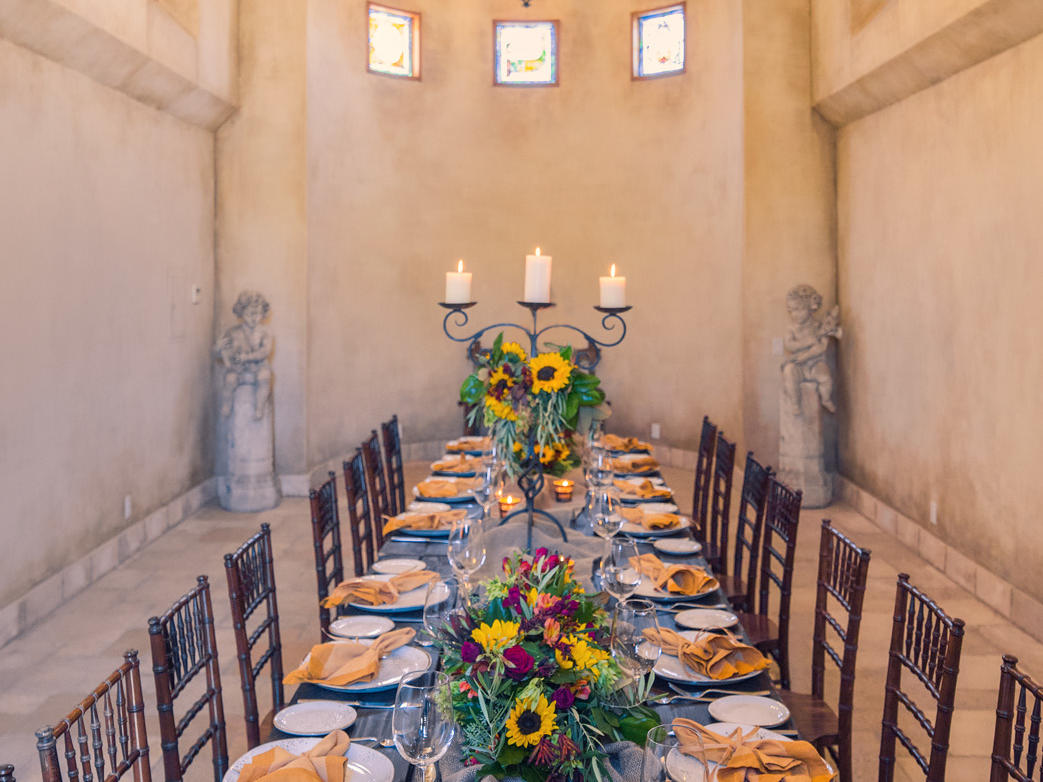 Dinner table set up inside Allegretto Abbey