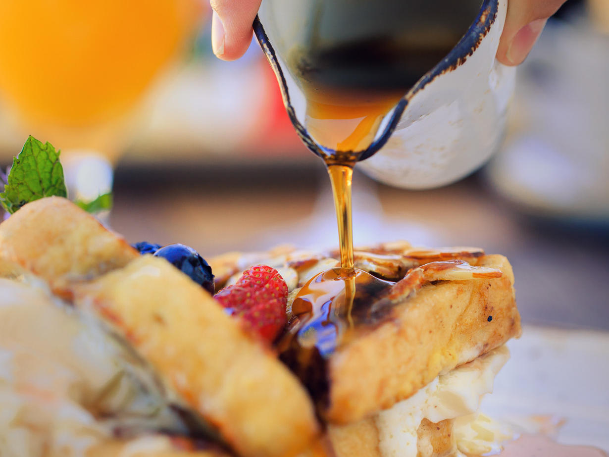 Syrup being poured onto french toast