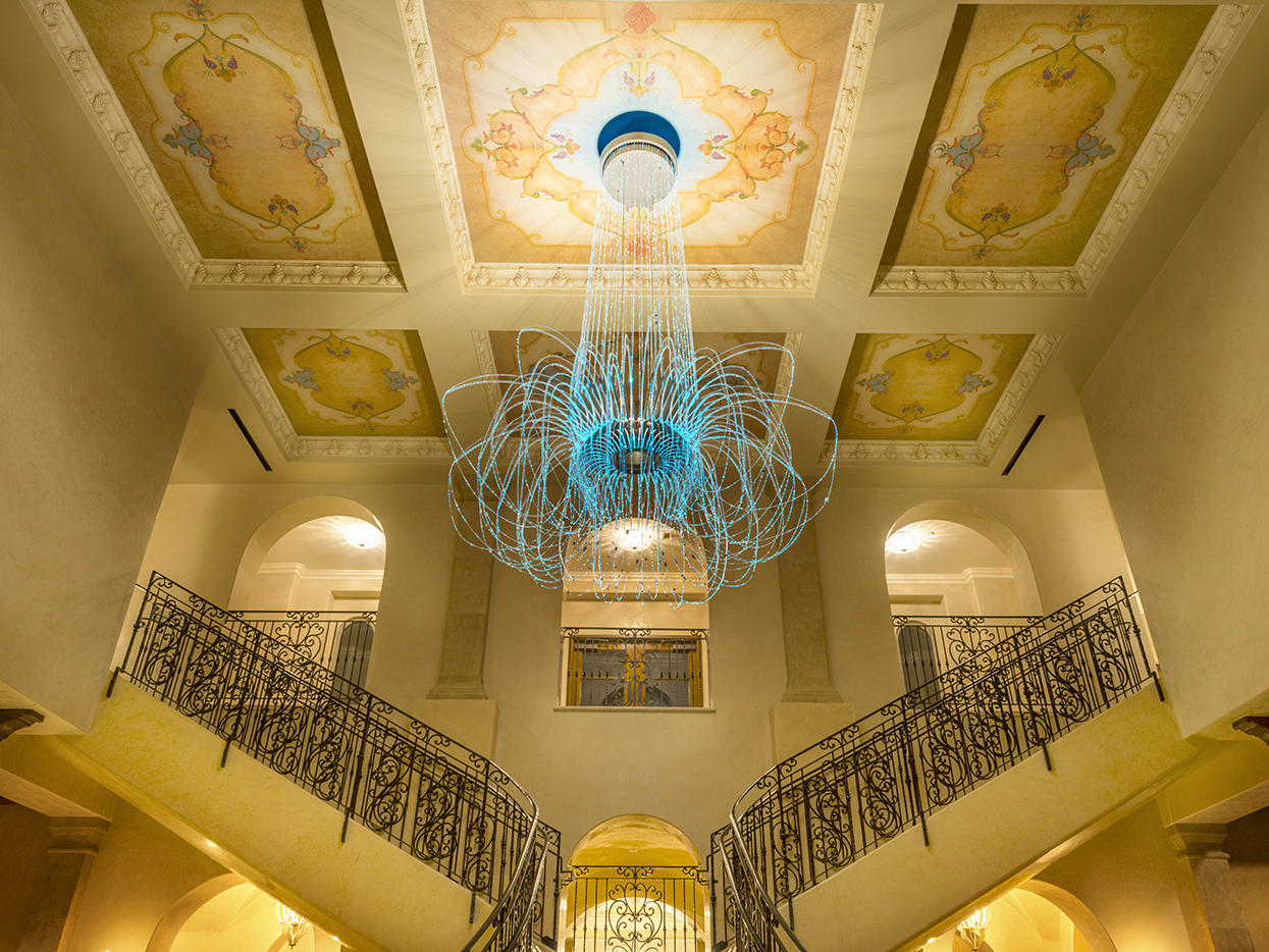 Chandelier above staircase in Allegretto Vineyard Resort lobby